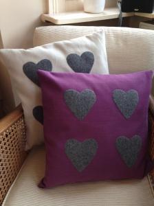 upcycled heart appliqué cushions